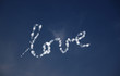 Love written in clouds in the sky