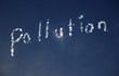 Pollution written in clouds in the sky