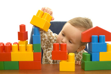 Cute baby girl with colorful blocks isolted background