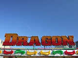 Dragon Sign on amusement ride. poster