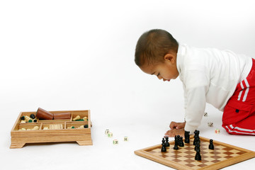 Child Playing with Different Toys
