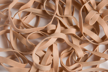 a pattern of rubber bands on a white seamless background