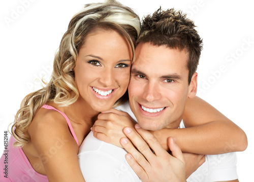 Young love couple smiling. Over white background  .