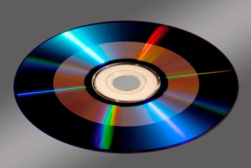 DVD / CD-ROM Disk Isolated on Gray with Clipping Path