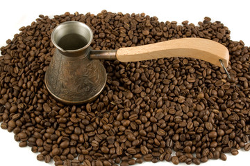 Cezve (ibrik) on a heap of coffee beans