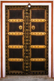 Decorated wooden door in the City Palace - Jaipur, India poster