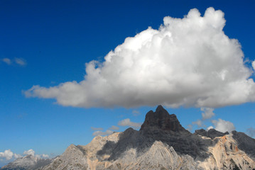 Landscape view of Dolomites mountain with white clouds