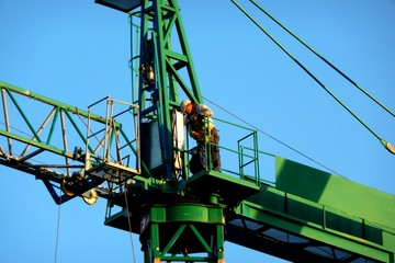 Man working at the top of a Crane