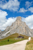 Landscape view of Dolomites mountain with hut