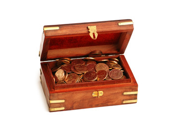 Wooden trunk full of golden coins isolated on white