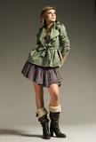 beautiful blonde girl wearing green coat and mini skirt  poster