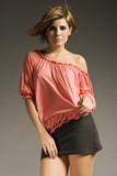 beautiful blonde girl wearing pink blouse and cotton mini skirt poster