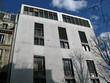 Immeuble gris  de béton et verre, Paris