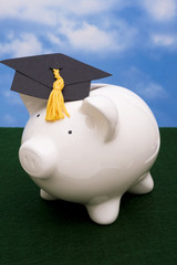 Piggy bank wearing graduation cap