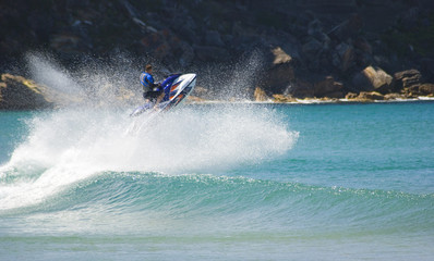 jetskier does amazing jump out of surf wave.