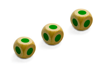 three  wooden Game dice  isolated on white background
