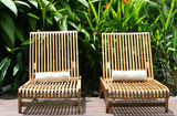 Two louge chairs await guest at a five star spa poster
