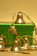 golden Christmas handbell and gift box