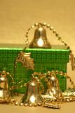 golden Christmas handbell and gift box