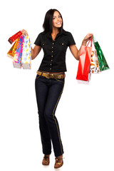 Shopping  woman smiling. Isolated over white background.