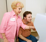 Senior woman volunteer explaining new voting machine