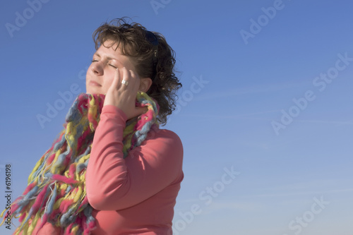 Woman trying to enjoy outside, but has a headache