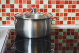 stainless pot on cooker poster