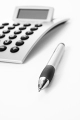 Pen and calculator (business background)