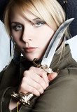 serious nordic girl with sharp knife poster