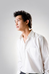 young man look up thinking with white shirt
