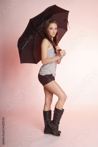 pretty woman with long brown hair and umbrella
