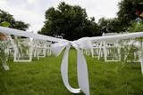 Isle runner ribbon at an outdoor wedding poster
