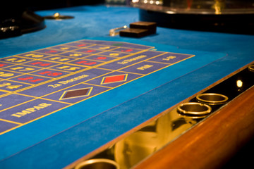details of roulette casino table on blue