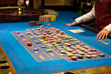 croupier preparing and counting money on roulette casino