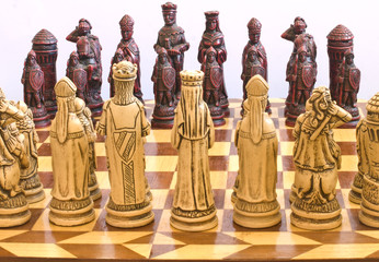 Chess pieces pictured against a white background