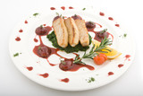 Dish from a tuna, grapes, sauce and greens, lemon and tomato poster
