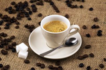 Cup of coffee on coffee sack
