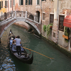 gondola on narrow canal Venice Italy