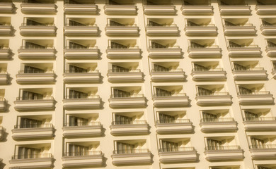 Rows of identical balconies on a white high rise resort hotel