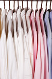 Mens Dress Shirts on Hangers in closet isolated over white