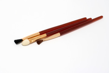 Aplicator and two brushes for make-up
