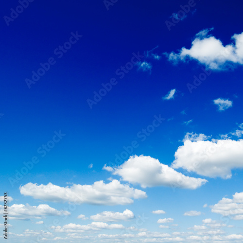 poster of White fluffy clouds in the blue sky.