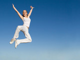 happy smiling successful woman jumping with joy poster