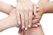 Sechs Hände aufeinander