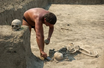 An archaeologist excavating an ancient burial
