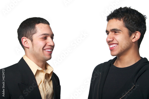 Two men smiling