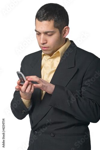 Business man dialing on cell phone