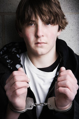 teen in handcuffs portrait close up
