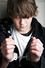 teen male portrait wearing handcuffs