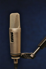 Microphone in professional studio on dark background